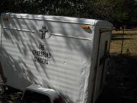 4x6 enclosed trailer for sale. $575 obo. The door of
