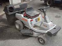 For sale is a Craftsman Ride-Around Lawnmower. It has