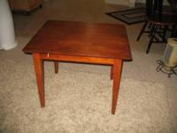 Good condition - long legged end table. call  or reply