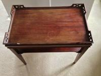 End table, mahogany woods.  , fair condition.. has