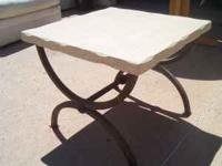 Faux travertine end table with iron base is perfect for