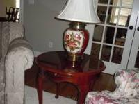 24 inch round cherry end table. Queen Anne legs.