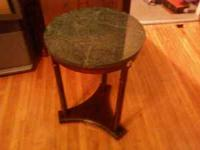 We have a end table with green marble top in great