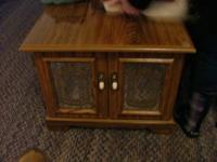 Nice size storage cabinet two drawer glass front. Call