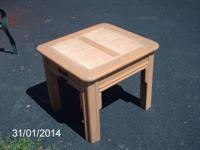We have a good Blond end table with a tile top. It is