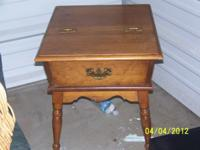 End table with starage all wood in excelant shape 25.00