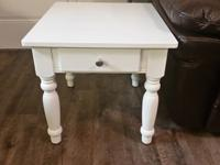 Two beautiful white end tables. Loved them so much when