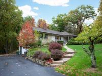 Set high on the east hill of Tenafly this updated ranch