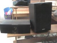 Center speaker, sub woofer, and two side speakers,