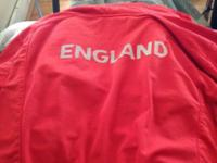 Red Jacket with England's three lions in the front and