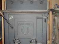 Englander wood stove with blow motor. The stove is 36h