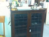 Antique and stunning with leaded glass doors. Floor or