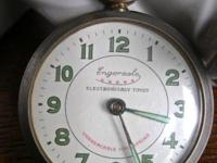 An open face antique pocket watch with a cool dial that