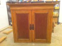 Entertainment / Armoire center with tuck in doors, This