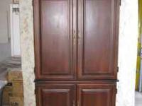 Heavy, solid wood armoire. Excellent condition, can be
