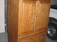 Sturdy oak entertainment cabinet with double doors on