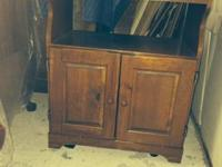 Charming strong wood entertainment cabinet. Even has