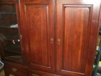 cherry wood entertainment cabinet in great condition,