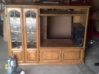 I have a really nice solid oak entertainment center for