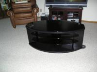 I have a modern black Entertainment Center with black
