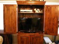 Nice dark wood TV Cabinet. Can holds a 32 inch LCD TV