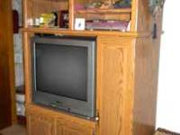 Entertainment Center is in great condition. Has a fold