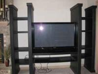 Black entertainment center in excellent condition,