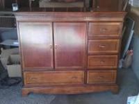 Used wooden entertainment center with multiple drawers