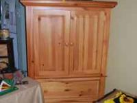 wood entertainment center $250 in excellent condition.