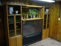SOLID OAK ENTERTAINMENT CENTER.....COMES WITH: 2