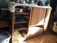 this is a solid oak entertainment center. it has