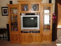 Oak entertainment center. Like new. 3 pieces. Glass