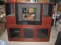 This beautiful cherry wood entertainment center