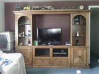 "Entertainment center 76"" high X 84"" wide 9 years old"
