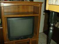nice entertainment center holds up to 36in. tv (TV