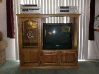 Oak entertainment center with glass styling, looks