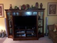 This is a beautiful Entertainment center made by