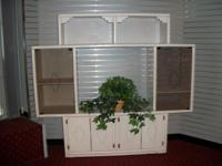 Whitewash southwestern entertainment center. Has space