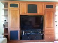 SOLID WOOD ENTERTAINMENT CENTER FOR SALE.BREAKS DOWN TO