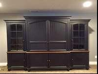 For sale is a Beautiful entertainment center that will