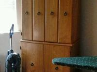 Beautiful light oak entertainment center. Has shelving