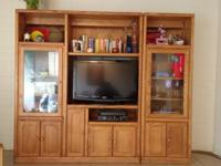 This entertainment center comes in two pieces. The main