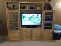 Solid Oak Entertainment center with lots of storage.
