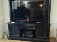 Nice, large entertainment center. It easily accomodates