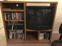 Entertainment center and Television for sale.**DVDs are