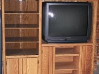 Oak entertainment center in great condition that comes