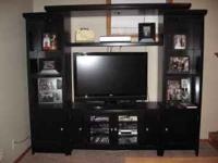 Black entertainment center for sale. We bought it new
