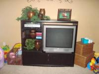 I am selling a black entertainment center that is in