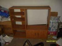 Selling a 7 year old entertainment center. Wood with