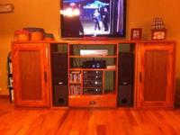 Beautiful solid pine entertainment center with plenty